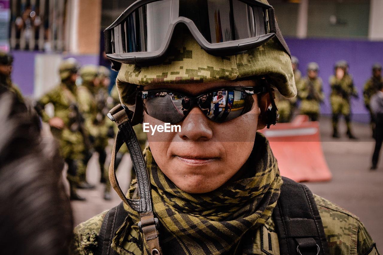 Portrait Of Army Soldier Wearing Uniform