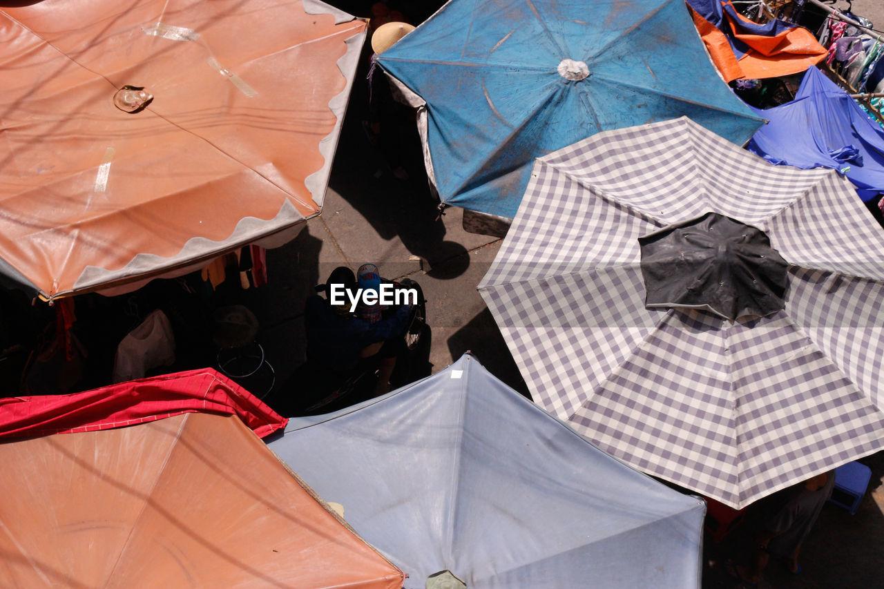 High angle view of umbrellas at market