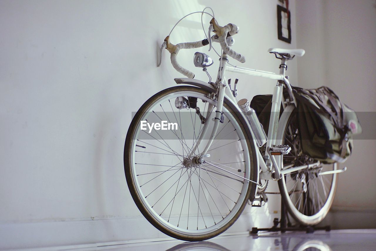 Close-Up Of Bicycle Parked On Floor At Home