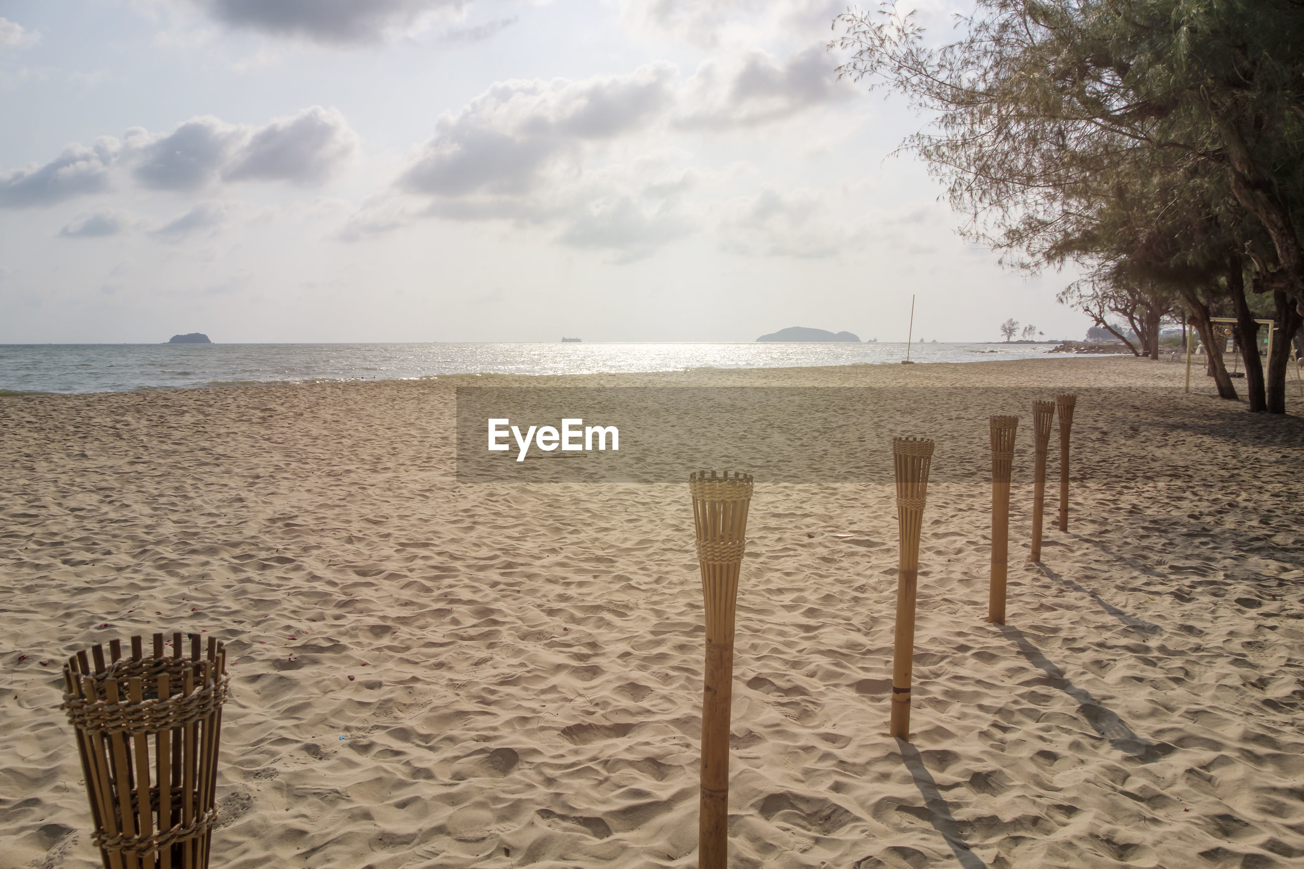 Beach theme concept for party with bamboo pole lamp to decorate and lighten the party on the beach