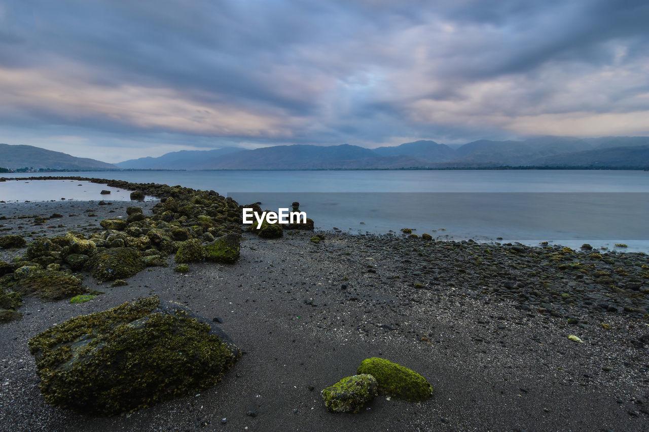 sky, water, cloud - sky, beauty in nature, scenics - nature, tranquility, nature, tranquil scene, plant, sea, no people, mountain, rock, rock - object, beach, solid, land, idyllic, outdoors