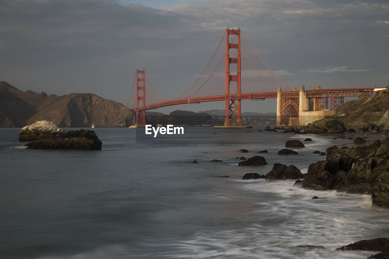 water, sky, bridge - man made structure, bridge, connection, built structure, sea, cloud - sky, suspension bridge, architecture, engineering, nature, rock, transportation, bay of water, bay, rock - object, waterfront, outdoors
