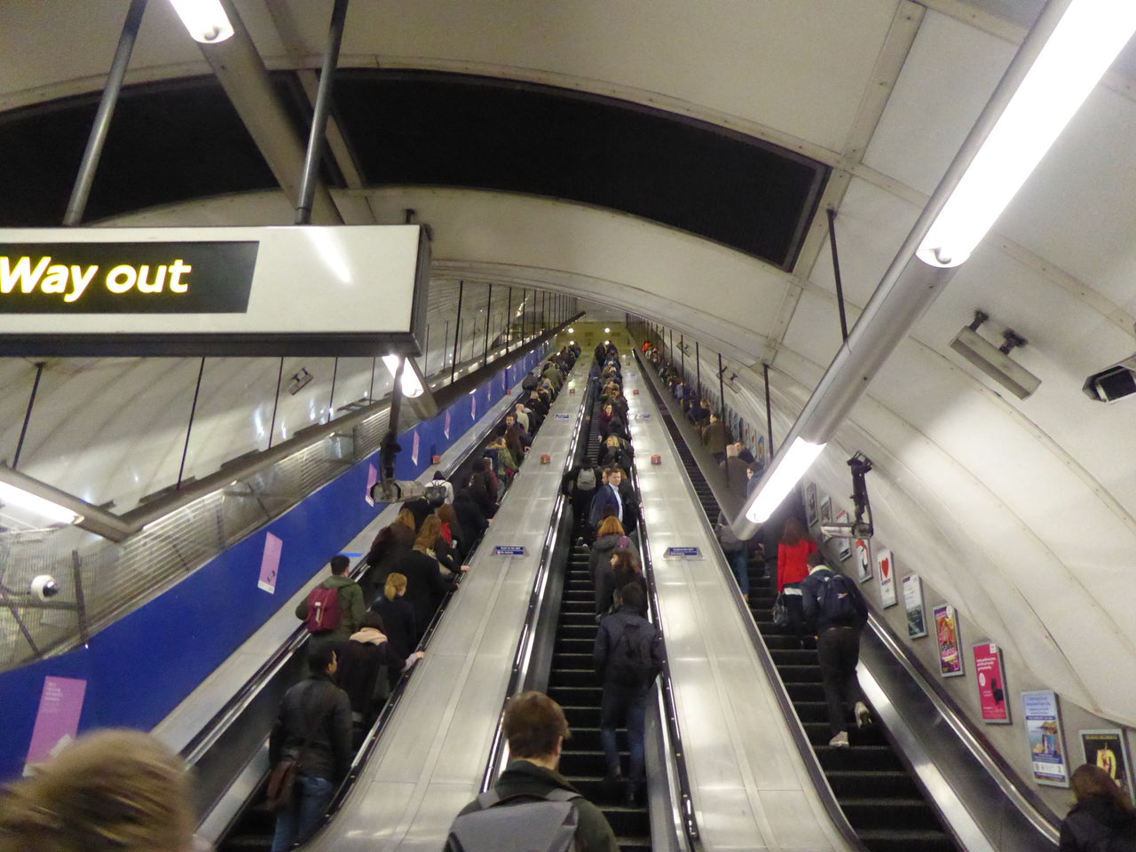 large group of people, transportation, escalator, indoors, real people, men, public transportation, subway station, steps and staircases, passenger, women, high angle view, modern, transportation building - type of building, illuminated, lifestyles, convenience, travel, journey, commuter, subway train, technology, architecture, crowd, day, people