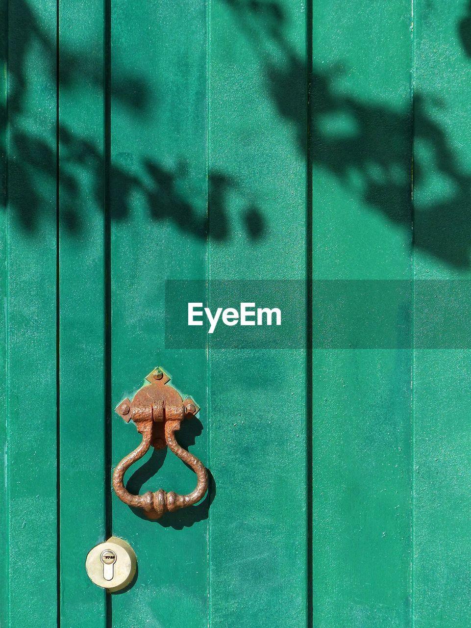 Close-Up Of Green Closed Door