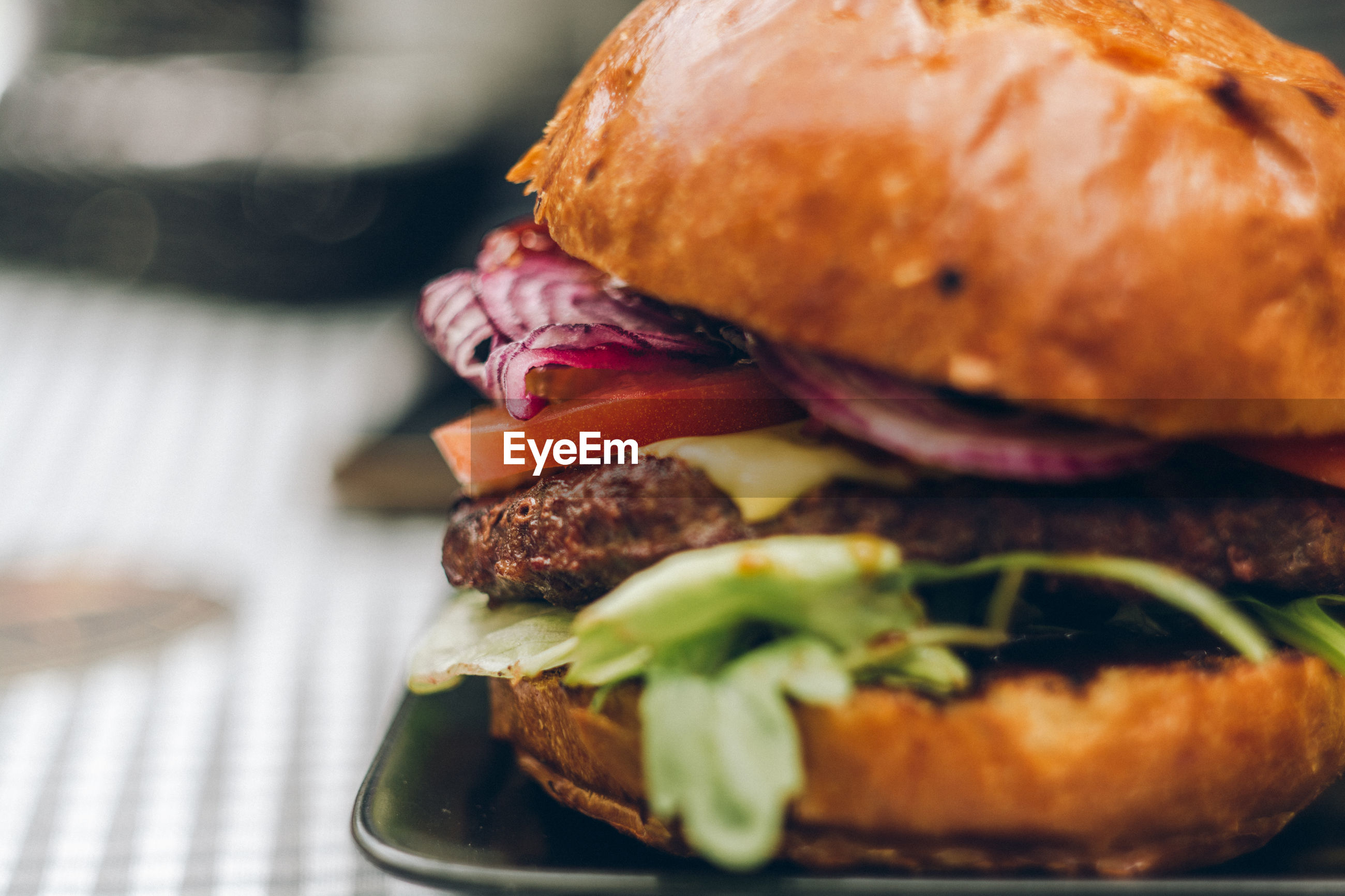 Close-up of hamburger in tray on table