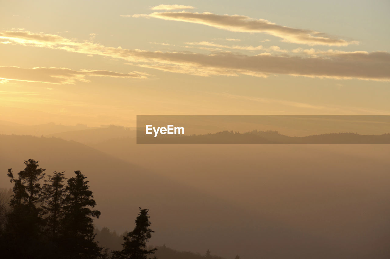 nature, sunset, beauty in nature, tranquility, tranquil scene, tree, scenics, mountain, no people, sky, hazy, landscape, outdoors, day