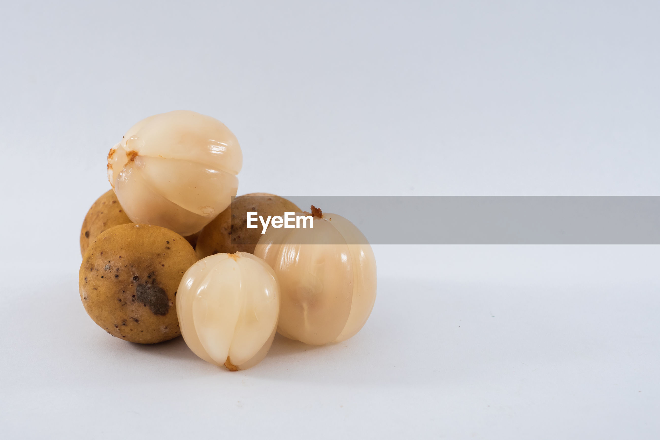 HIGH ANGLE VIEW OF EGGS IN WHITE BACKGROUND