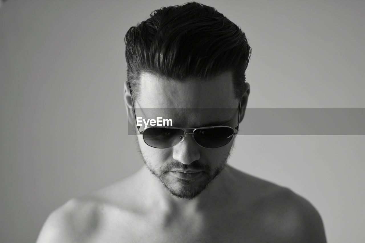 Close-Up Portrait Of Shirtless Man Wearing Sunglasses