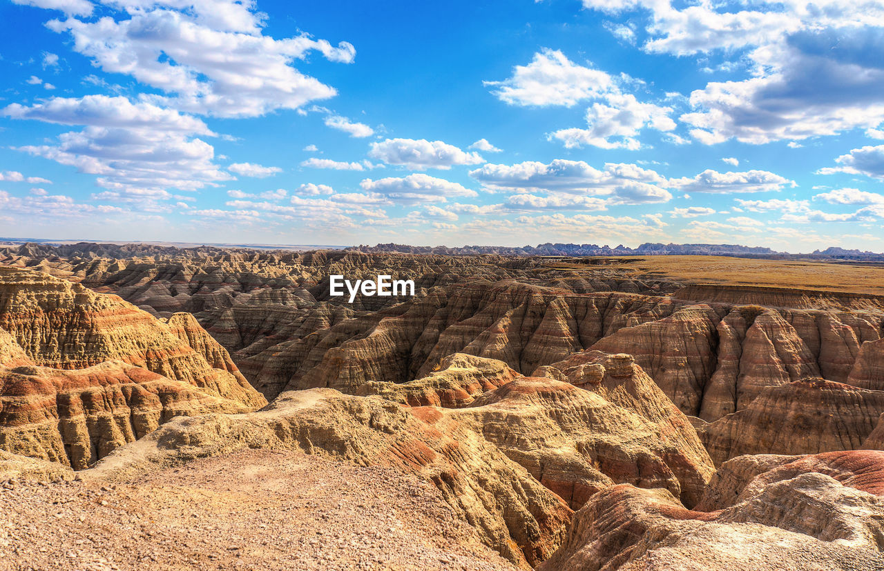 sky, scenics - nature, rock, cloud - sky, landscape, beauty in nature, rock formation, rock - object, non-urban scene, tranquil scene, tranquility, environment, solid, mountain, physical geography, nature, geology, travel destinations, remote, no people, mountain range, climate, arid climate, formation, outdoors, dramatic landscape, eroded