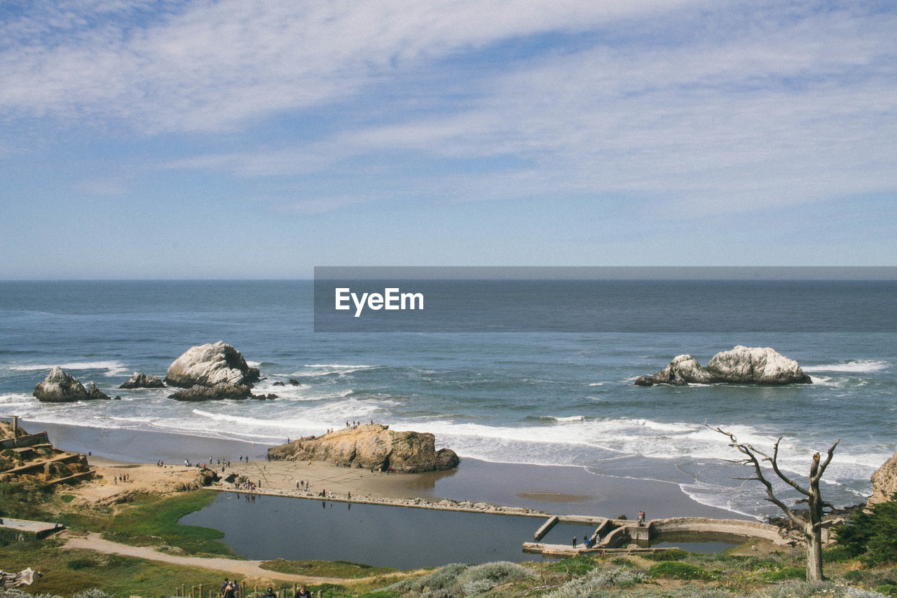 High Angle View Of Sutro Baths By Sea Against Cloudy Sky