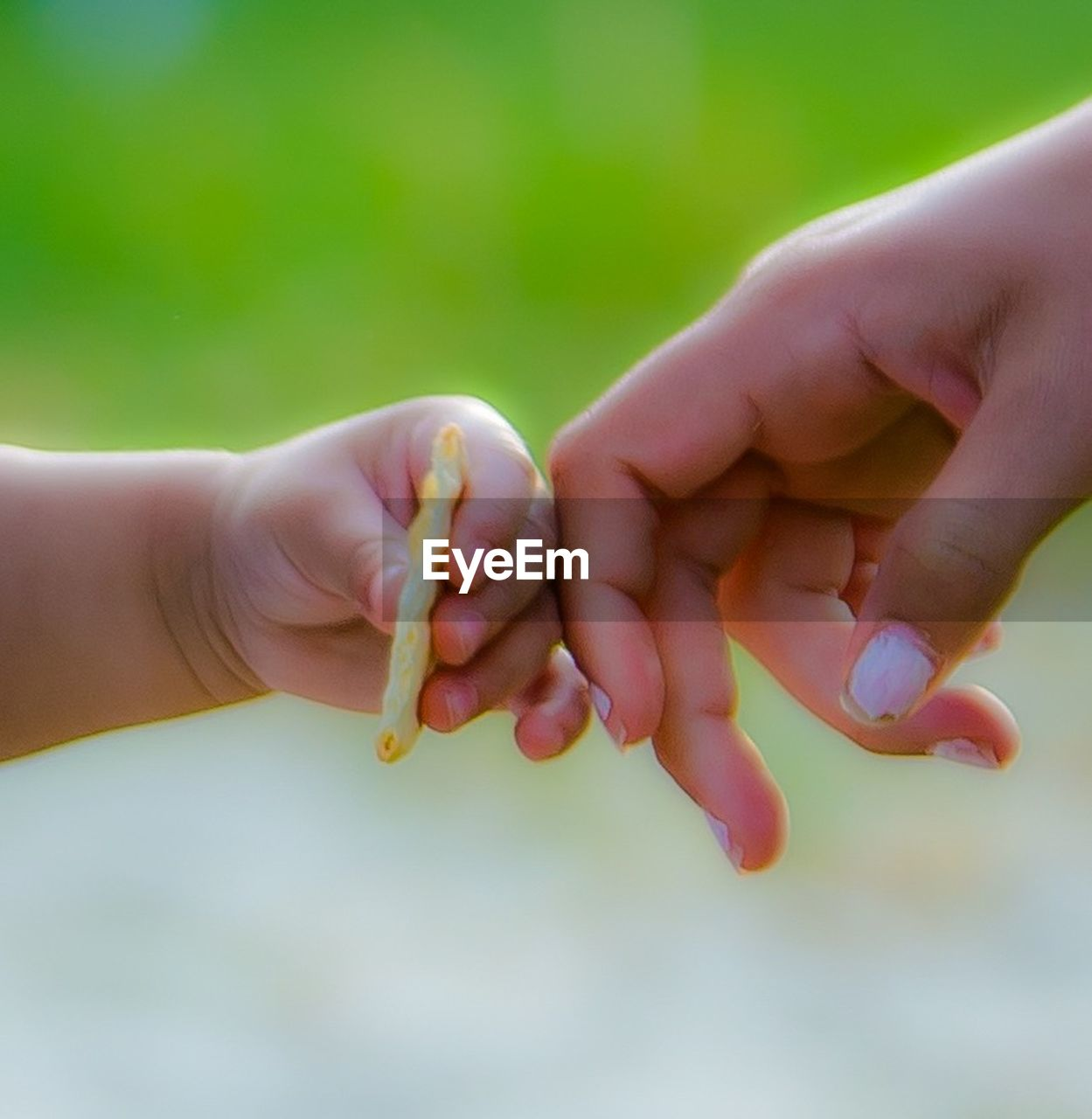human hand, human body part, togetherness, real people, family with one child, baby, bonding, childhood, love, focus on foreground, family, holding, mother, close-up, care, women, men, day, outdoors, people