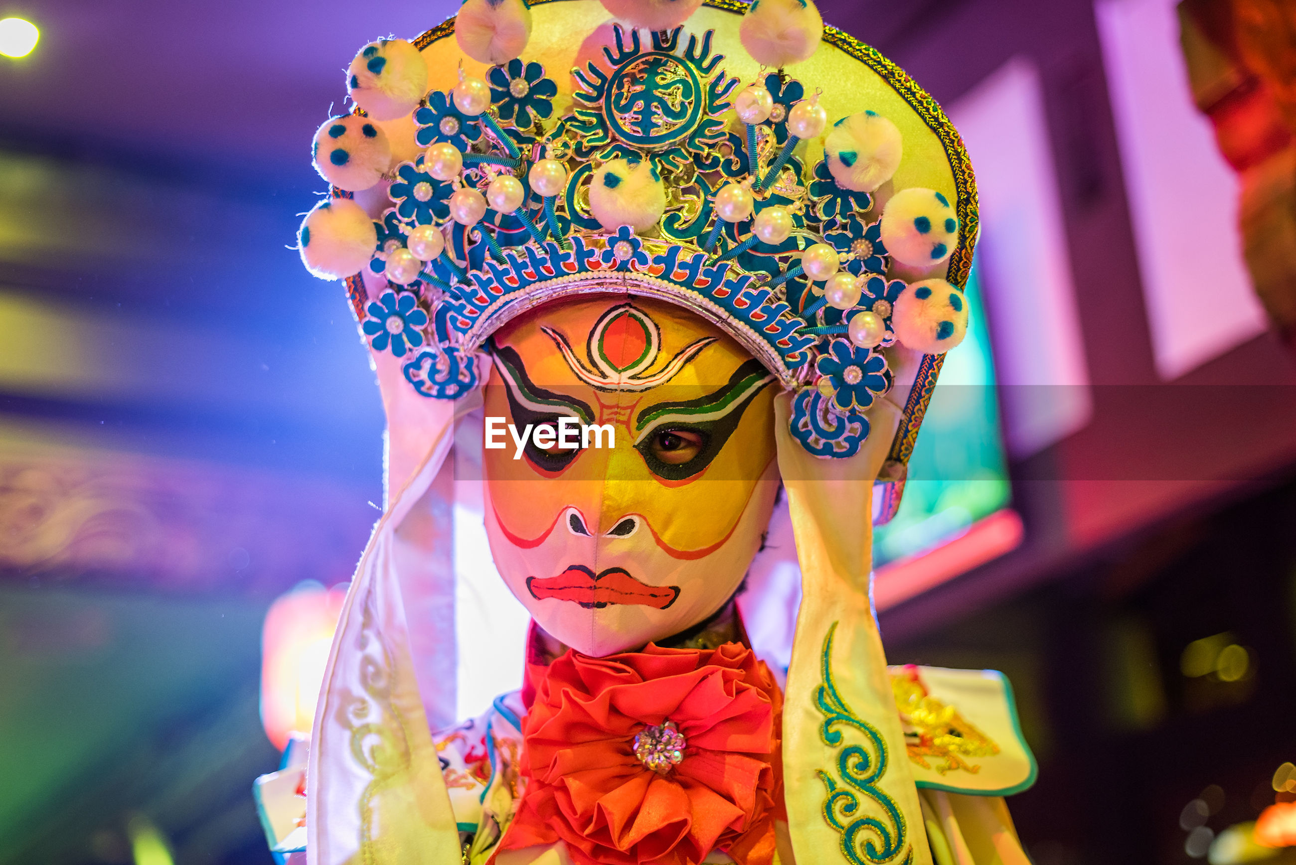 CLOSE-UP OF COLORFUL MASK