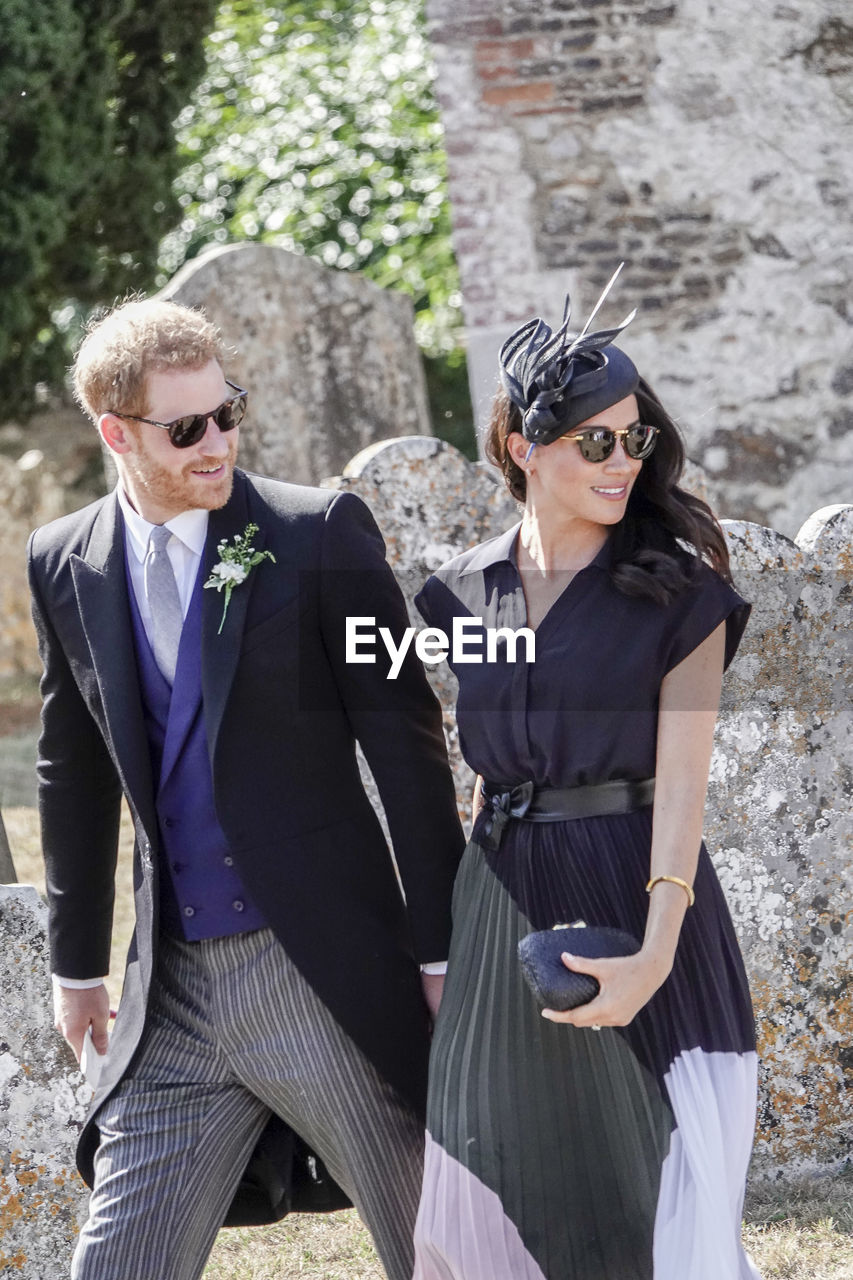 two people, fashion, real people, young adult, young women, standing, three quarter length, lifestyles, looking at camera, togetherness, sunglasses, adult, glasses, front view, people, women, day, clothing, leisure activity, couple - relationship, outdoors, beautiful woman