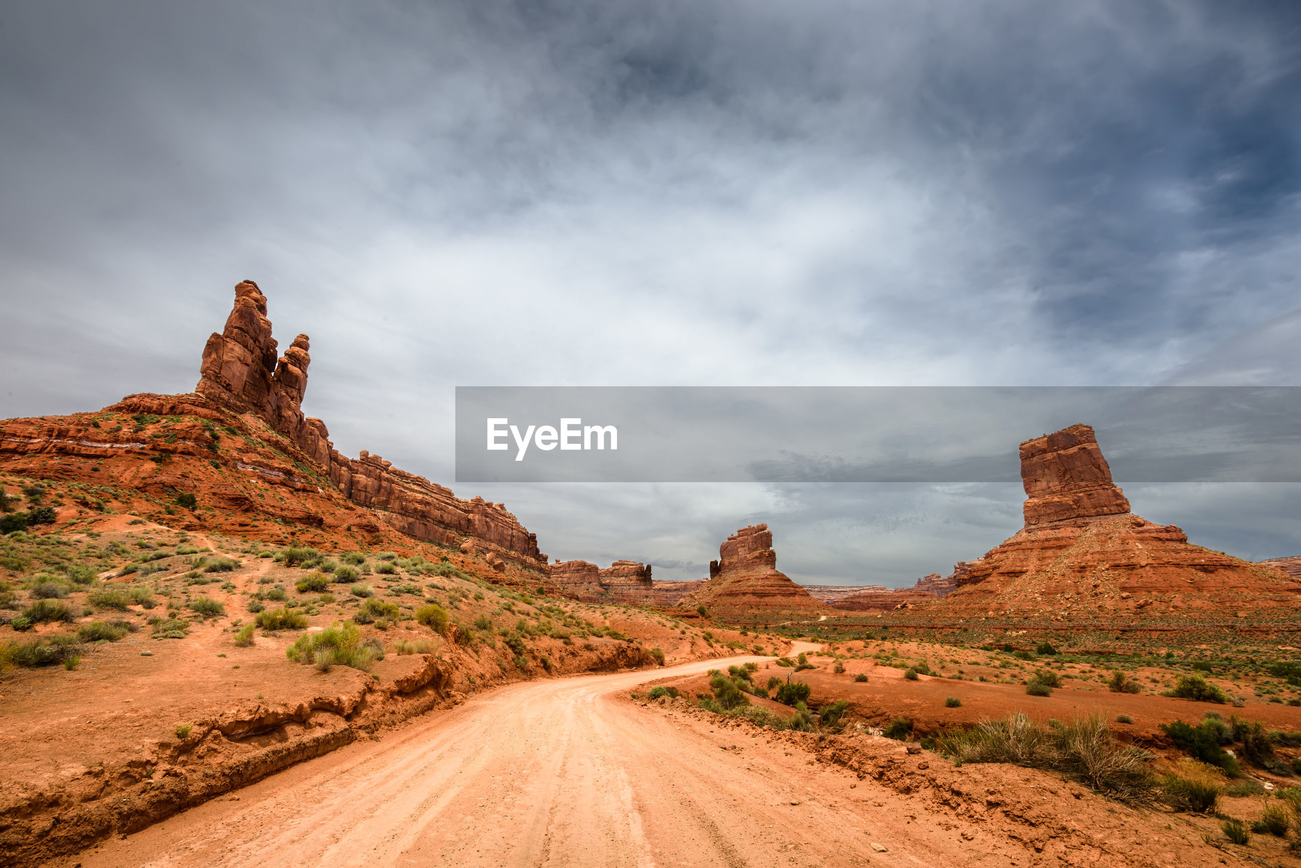PANORAMIC VIEW OF ROCK FORMATIONS ON ROAD AGAINST SKY