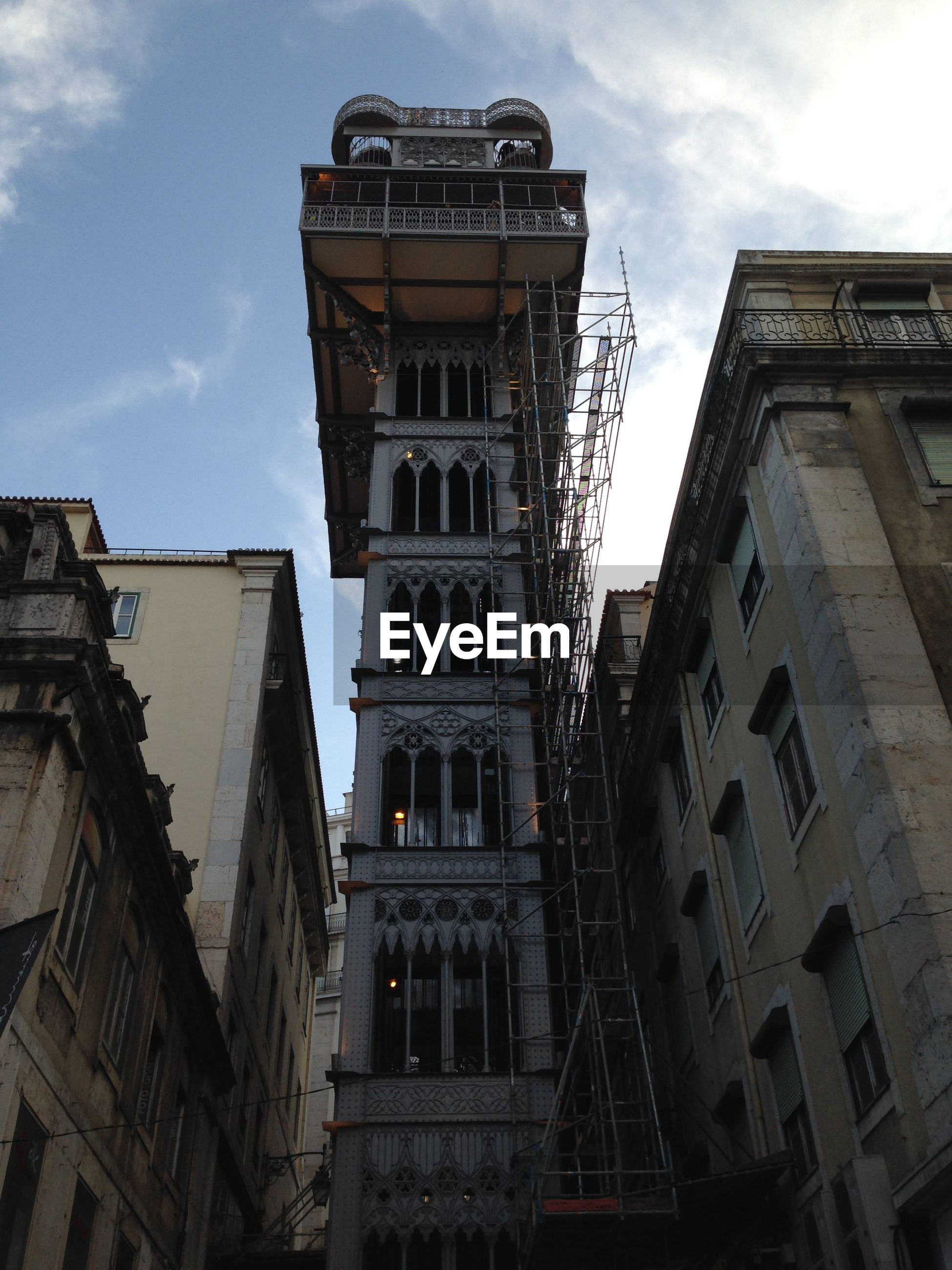 Low angle view of carmo lift by buildings against sky