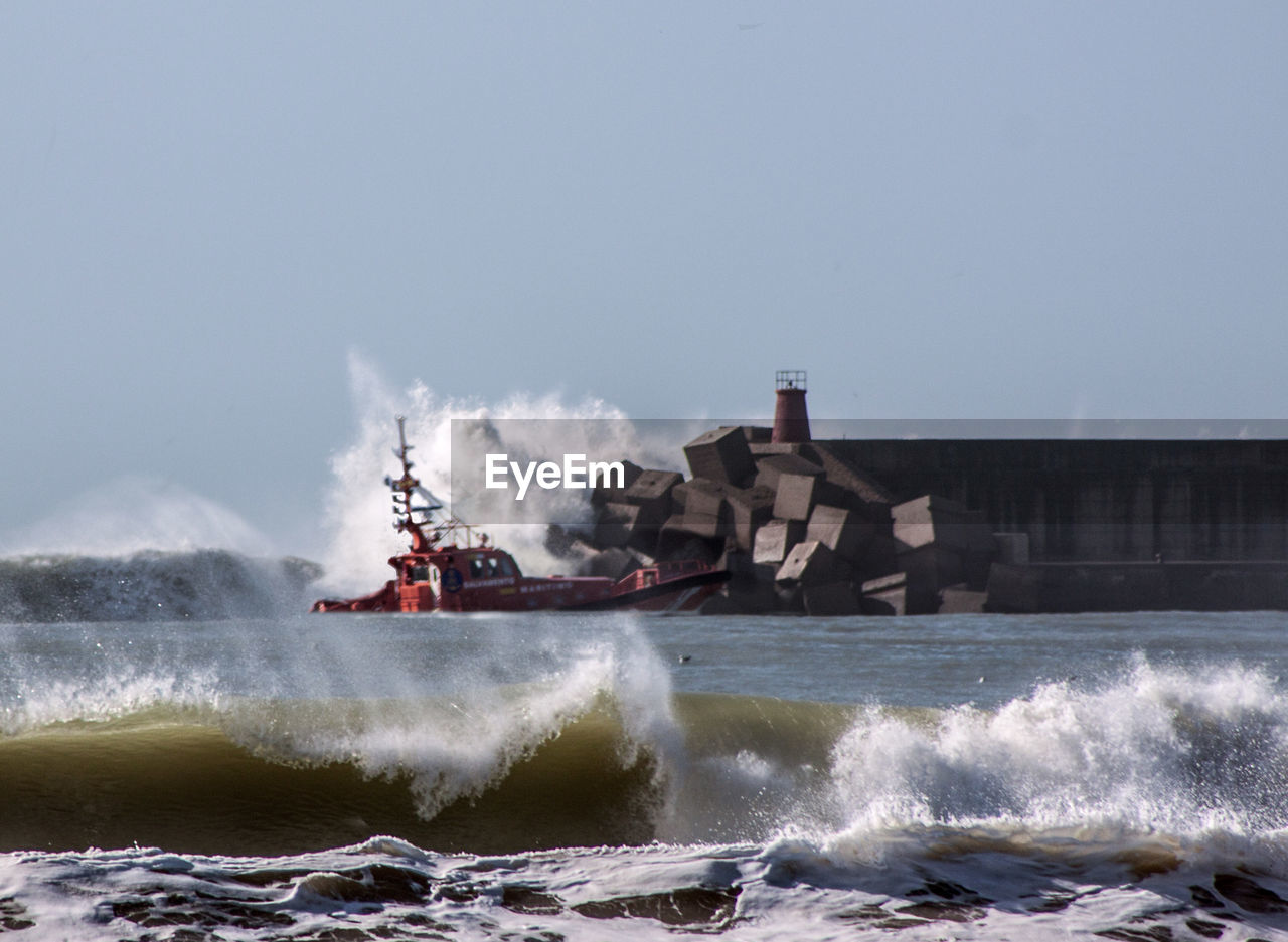 motion, splashing, water, speed, spraying, outdoors, day, transportation, risk, sea, hitting, force, clear sky, wave, nautical vessel, power in nature, crash, nature, no people, sky