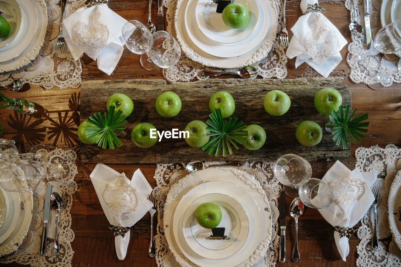 High angle view of granny smith apple in plate on table