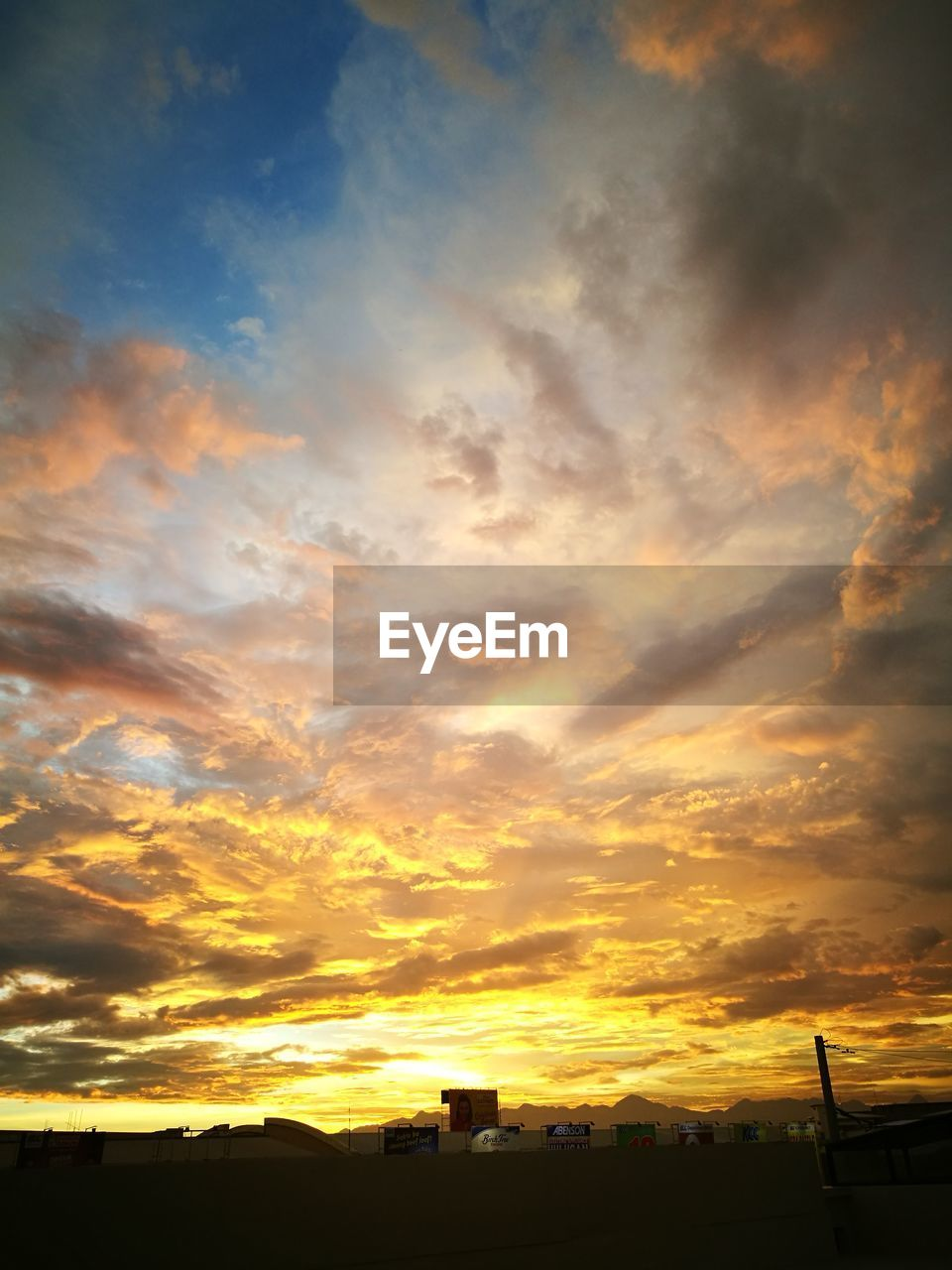 cloud - sky, sky, sunset, silhouette, scenics - nature, orange color, beauty in nature, no people, nature, architecture, building exterior, tranquil scene, tranquility, built structure, landscape, idyllic, outdoors, sunlight, dramatic sky, environment