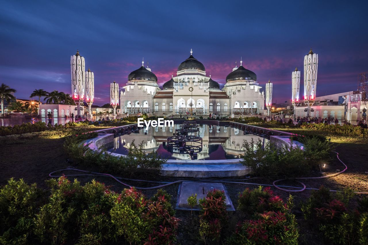 building exterior, architecture, built structure, sky, city, building, travel destinations, water, nature, cloud - sky, illuminated, dome, no people, plant, tourism, travel, dusk, history, outdoors, cityscape, government, luxury