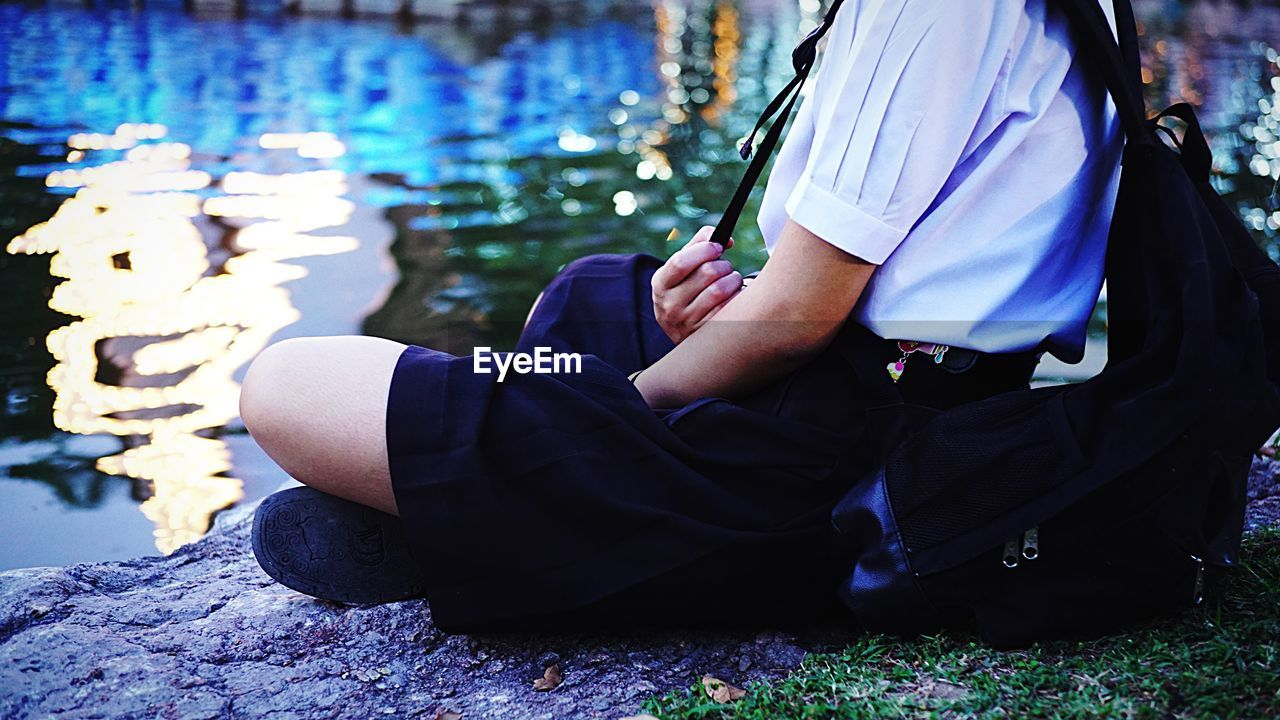 Close-Up Of Schoolgirl Sitting Outdoors