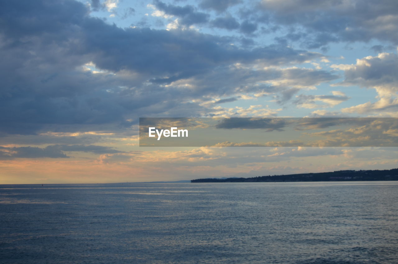 cloud - sky, sky, sunset, beauty in nature, sea, scenics - nature, tranquility, water, tranquil scene, nature, horizon over water, horizon, waterfront, no people, outdoors, idyllic, non-urban scene, orange color, dusk