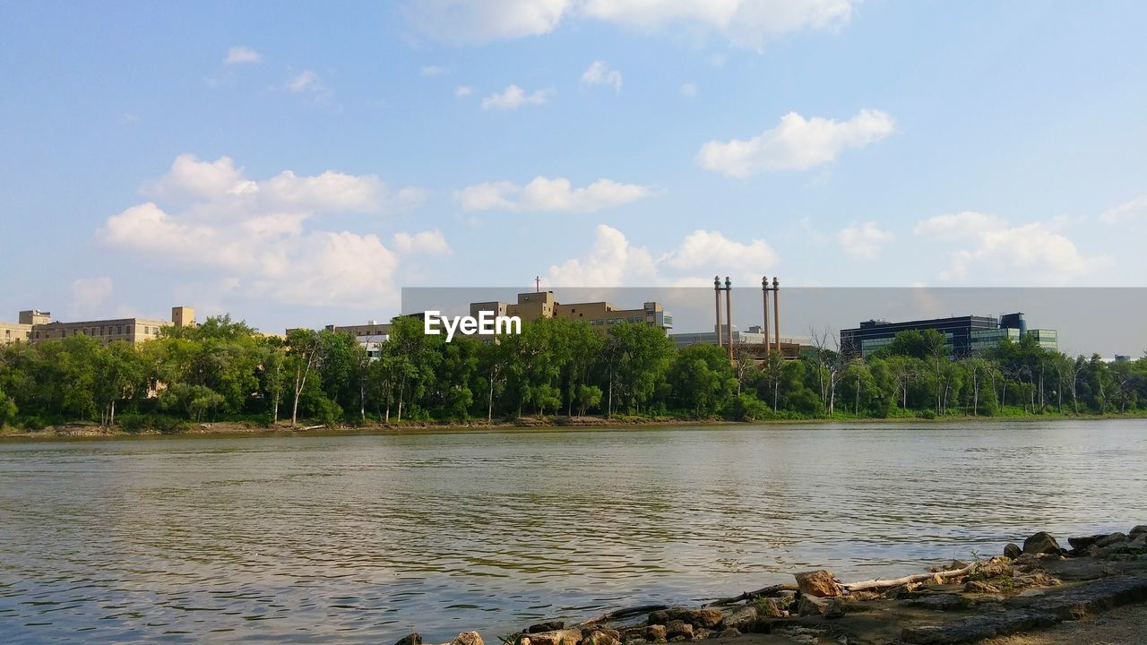 architecture, sky, built structure, building exterior, city, river, no people, tree, water, growth, cityscape, outdoors, skyscraper, nature, industry, day