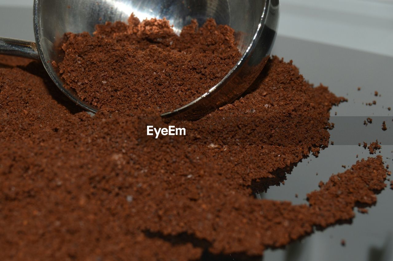 food and drink, food, indoors, freshness, brown, chocolate, close-up, still life, ground coffee, no people, selective focus, sweet food, ground - culinary, table, coffee - drink, coffee, high angle view, dessert, day, sweet, temptation, chocolate cake