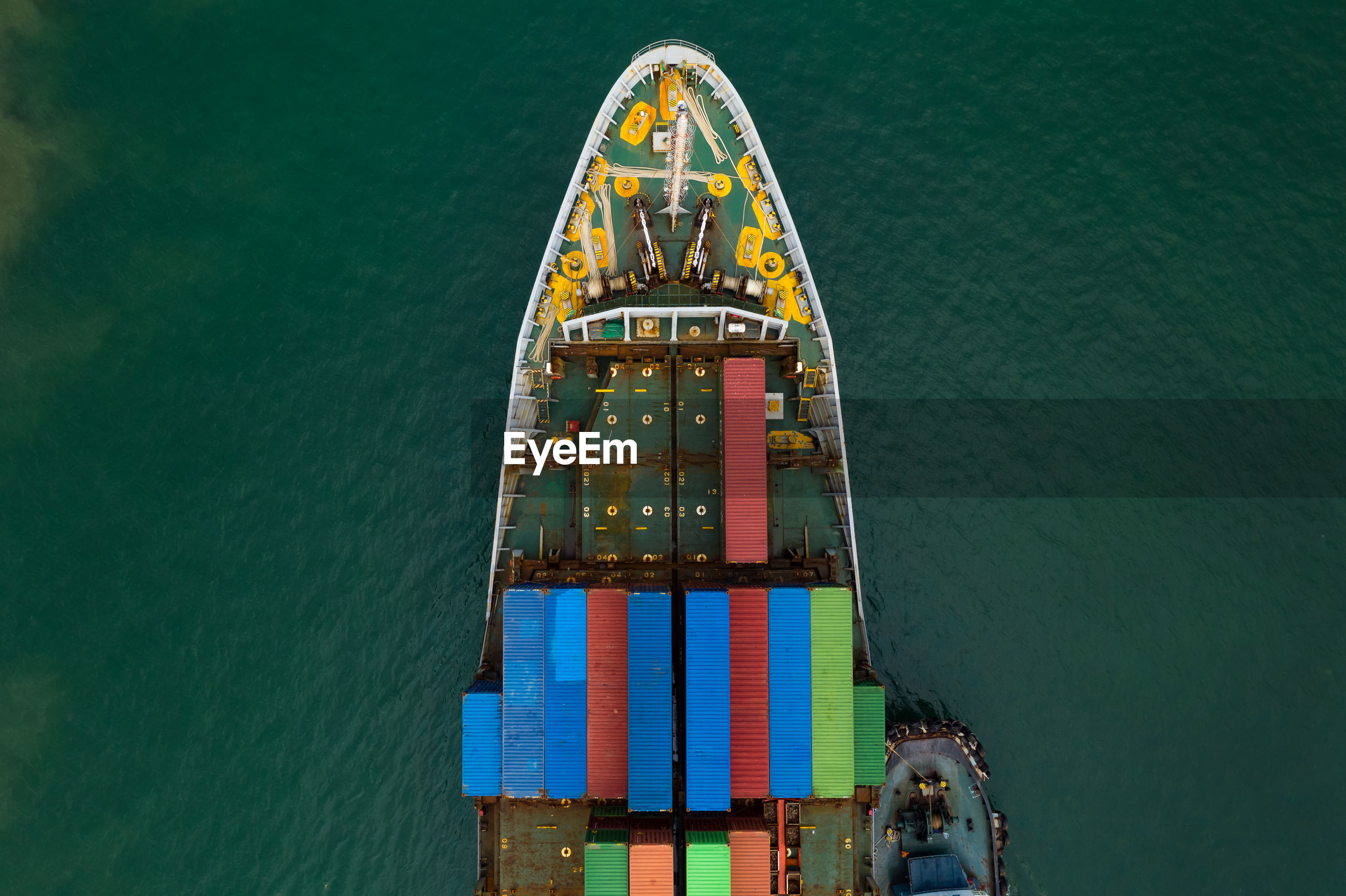 High angle view shipping containers transportation sailing on the sea