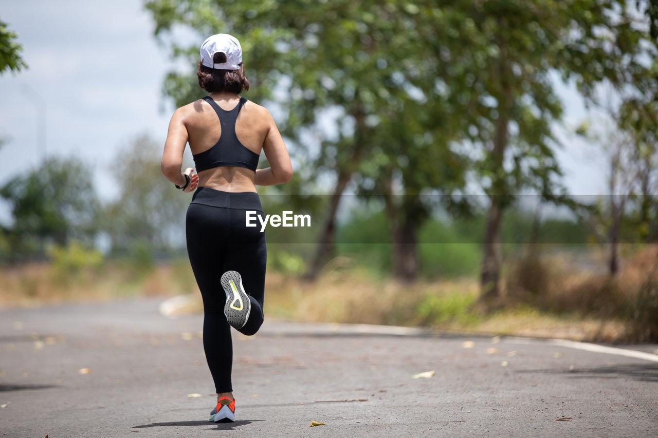 Full length of man running on road