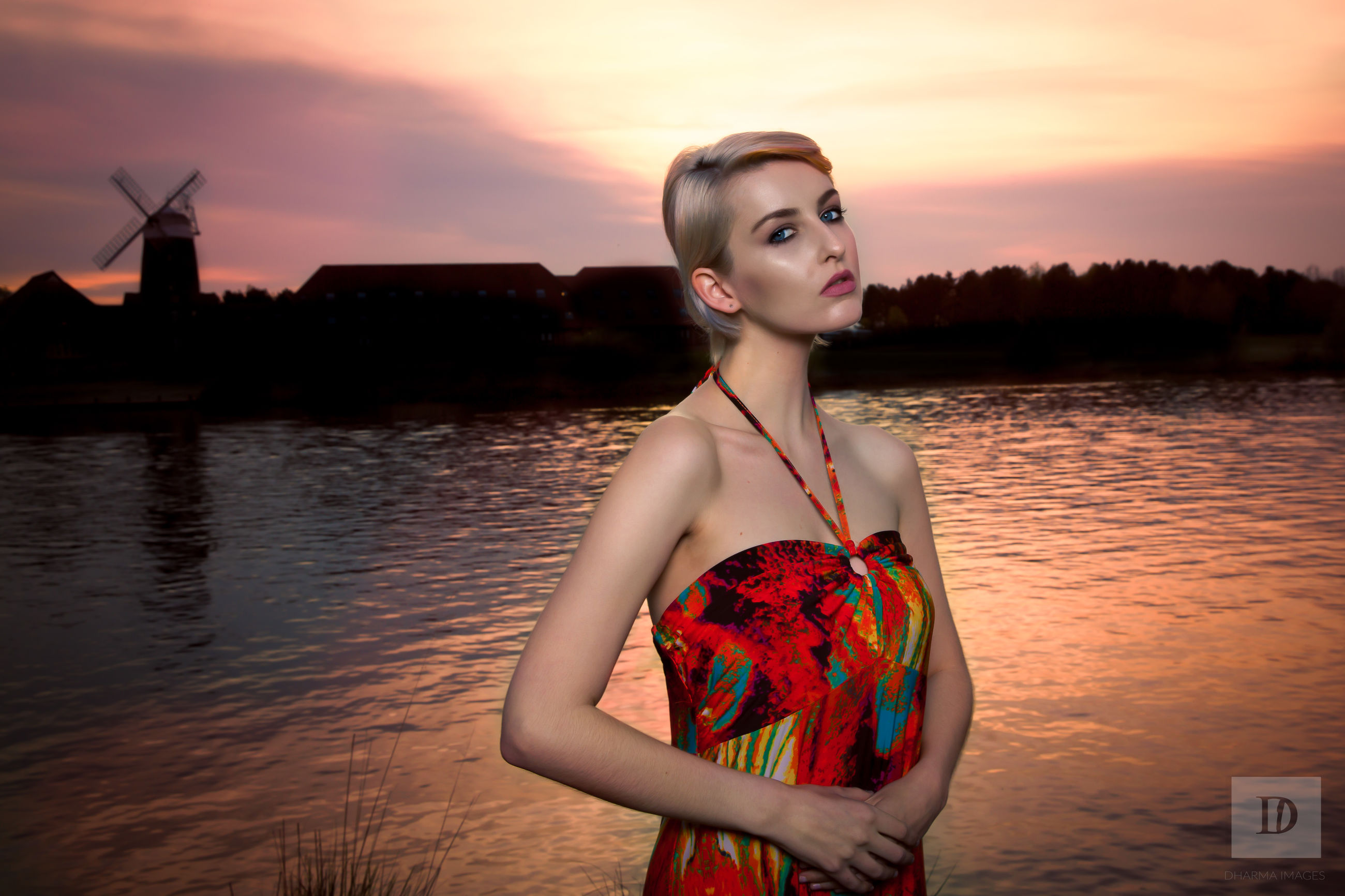 water, young adult, sunset, person, lifestyles, sky, leisure activity, young women, three quarter length, standing, holding, lake, front view, looking at camera, portrait, waist up, red