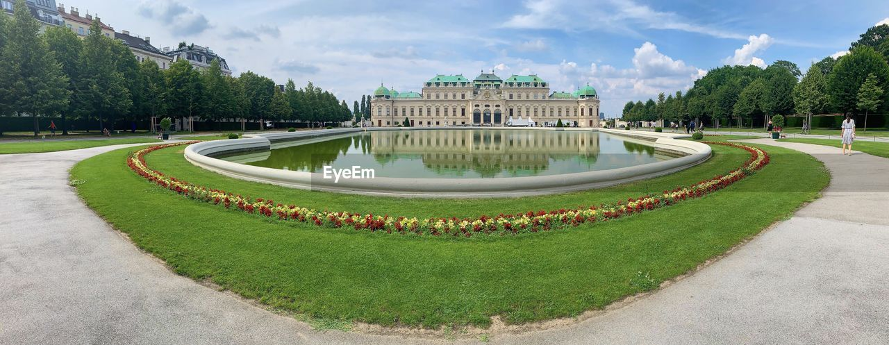 plant, architecture, tree, built structure, green color, grass, nature, garden, day, sky, cloud - sky, growth, building exterior, formal garden, water, travel destinations, park, park - man made space, no people, outdoors, government, hedge