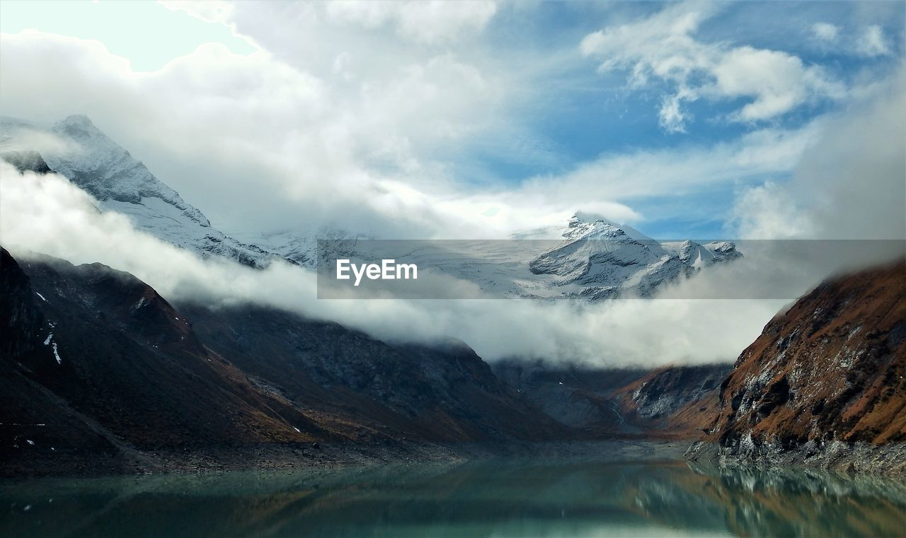 mountain, cold temperature, beauty in nature, nature, winter, scenics, tranquility, snow, sky, weather, tranquil scene, cloud - sky, mountain range, ice, frozen, outdoors, day, no people, lake, water, snowcapped mountain, glacier, landscape, iceberg
