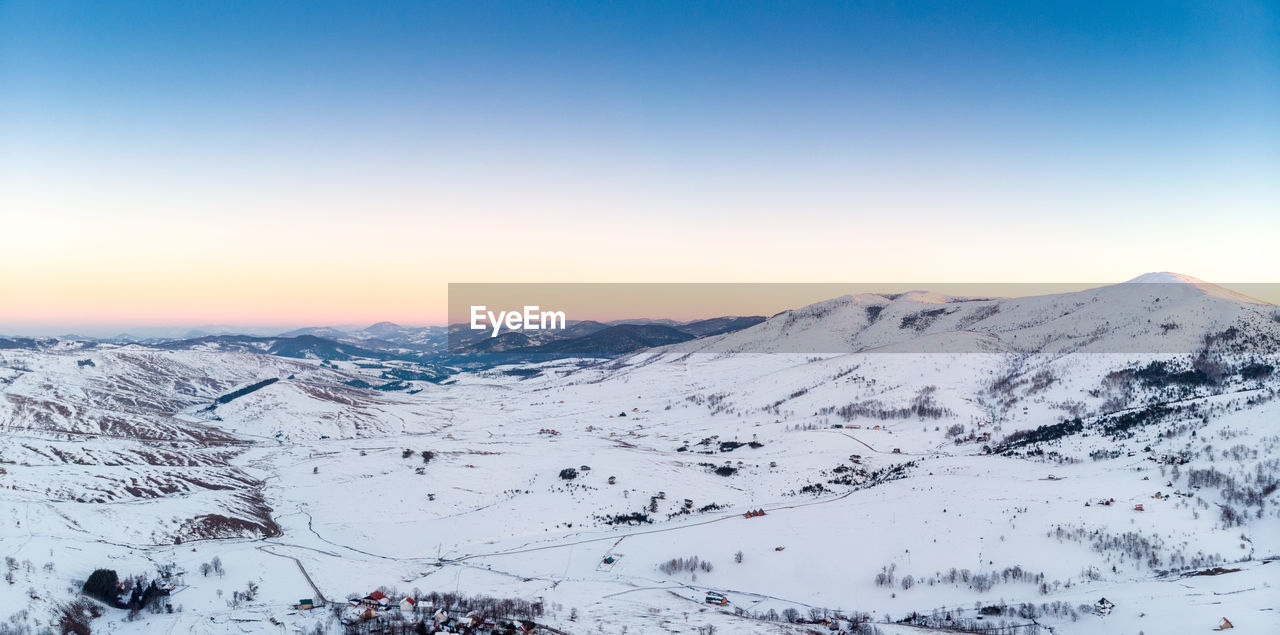 snow, cold temperature, mountain, winter, sky, scenics - nature, beauty in nature, tranquil scene, environment, tranquility, landscape, nature, clear sky, non-urban scene, copy space, mountain range, snowcapped mountain, idyllic, no people, range, mountain peak
