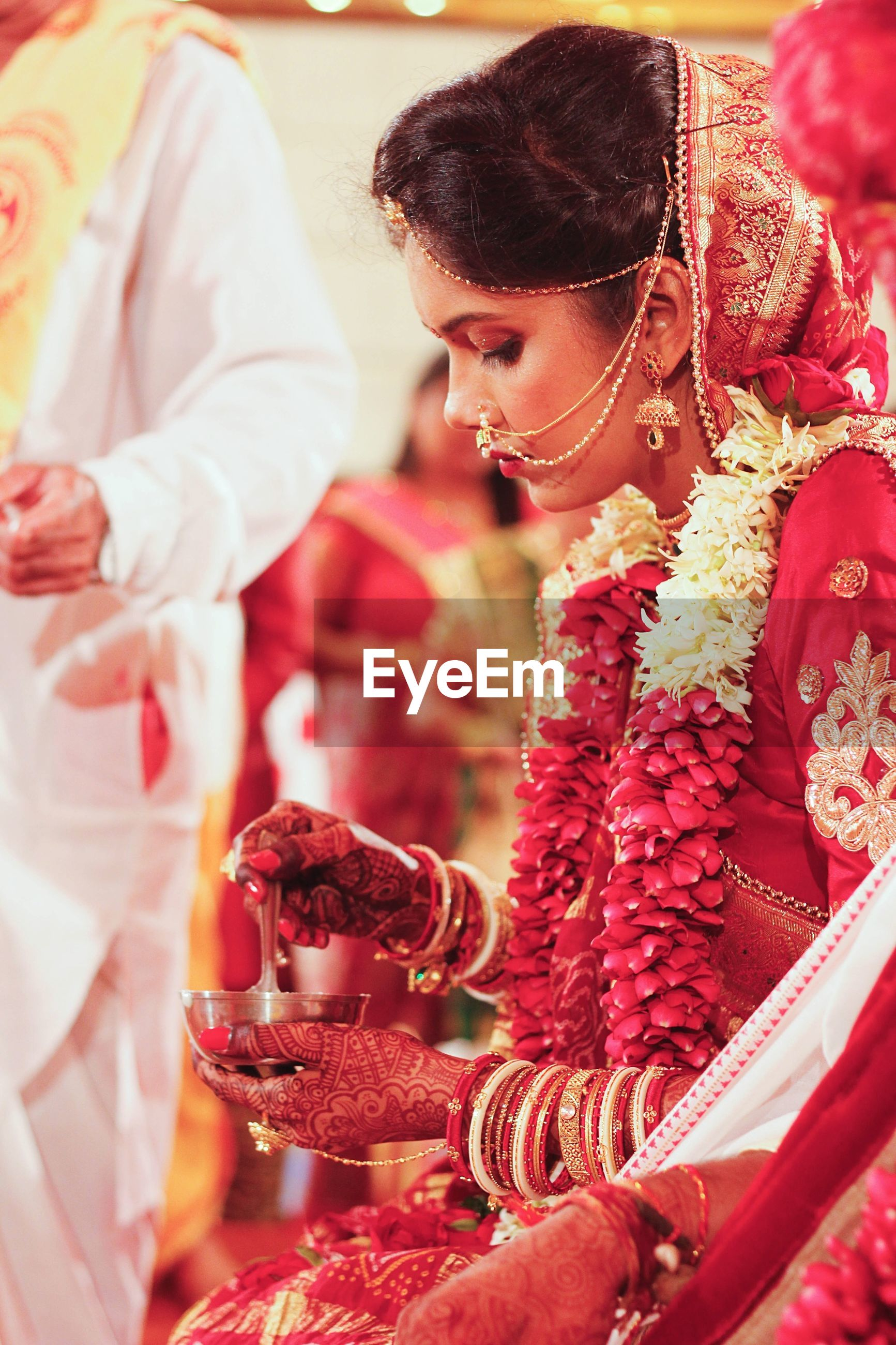 Midsection of bride performing rituals