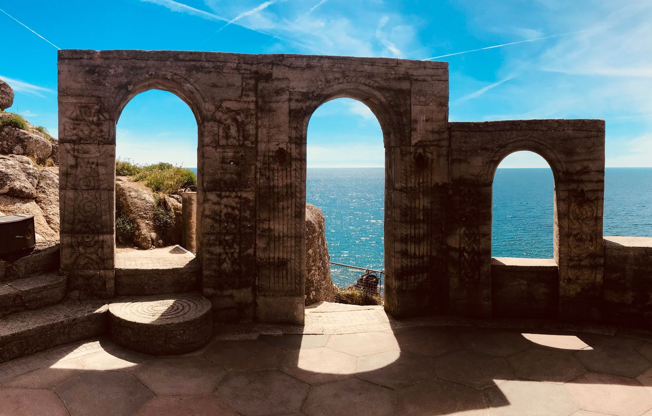 water, architecture, arch, nature, sky, sea, built structure, sunlight, day, no people, shadow, horizon over water, history, the past, horizon, travel destinations, outdoors, tourism, beauty in nature, architectural column, ancient civilization