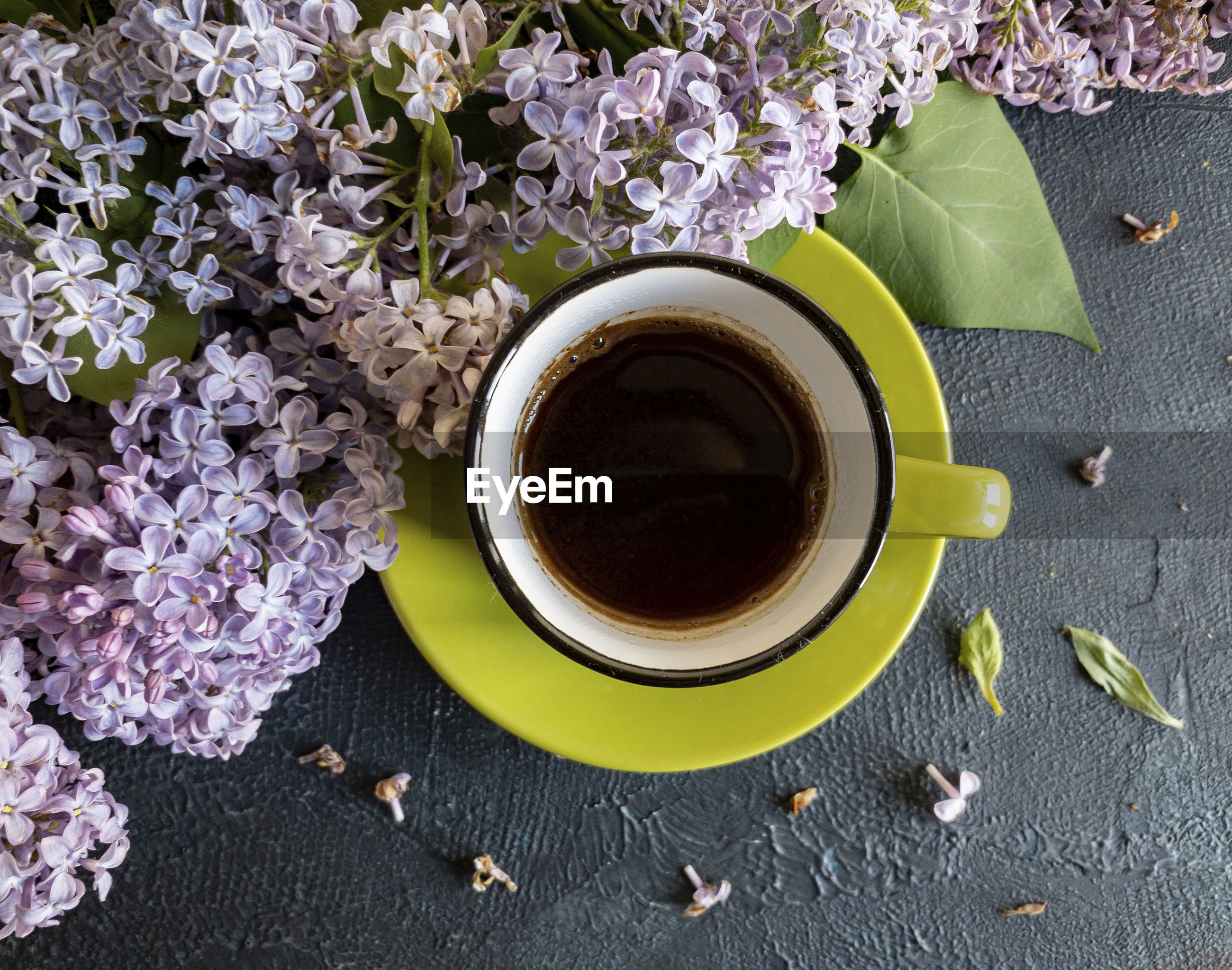 Directly above shot of coffee with flower on table