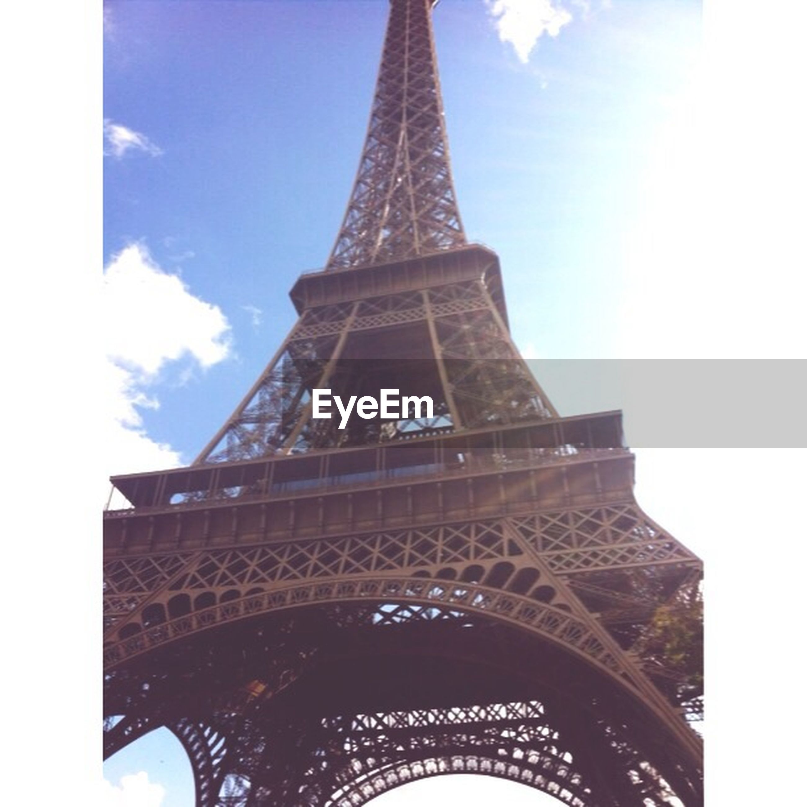 architecture, eiffel tower, built structure, low angle view, famous place, international landmark, tower, tall - high, travel destinations, capital cities, tourism, culture, sky, travel, metal, architectural feature, history, city, building exterior, day