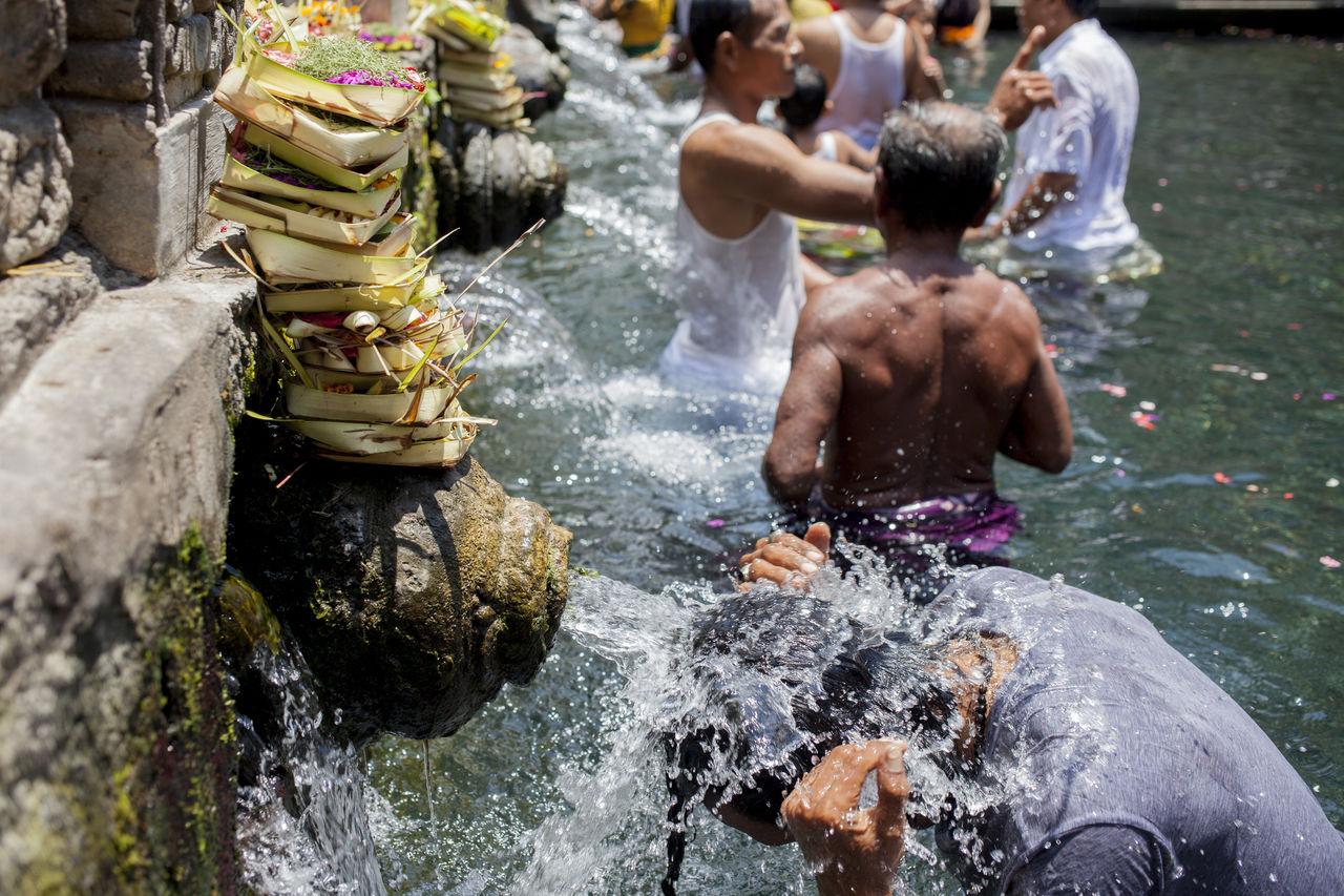 Men bathing at pura tirta empul temple