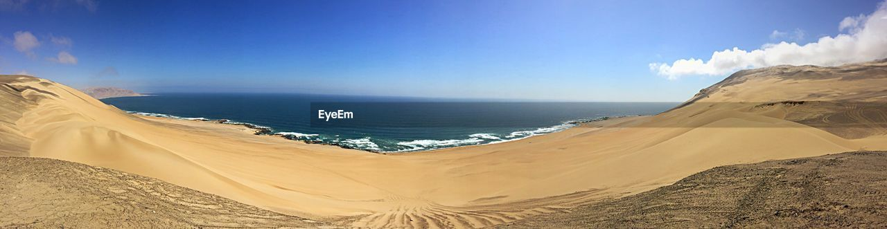 sea, nature, sand, beauty in nature, tranquility, beach, scenics, tranquil scene, sky, horizon over water, water, day, outdoors, blue, landscape, sand dune, no people