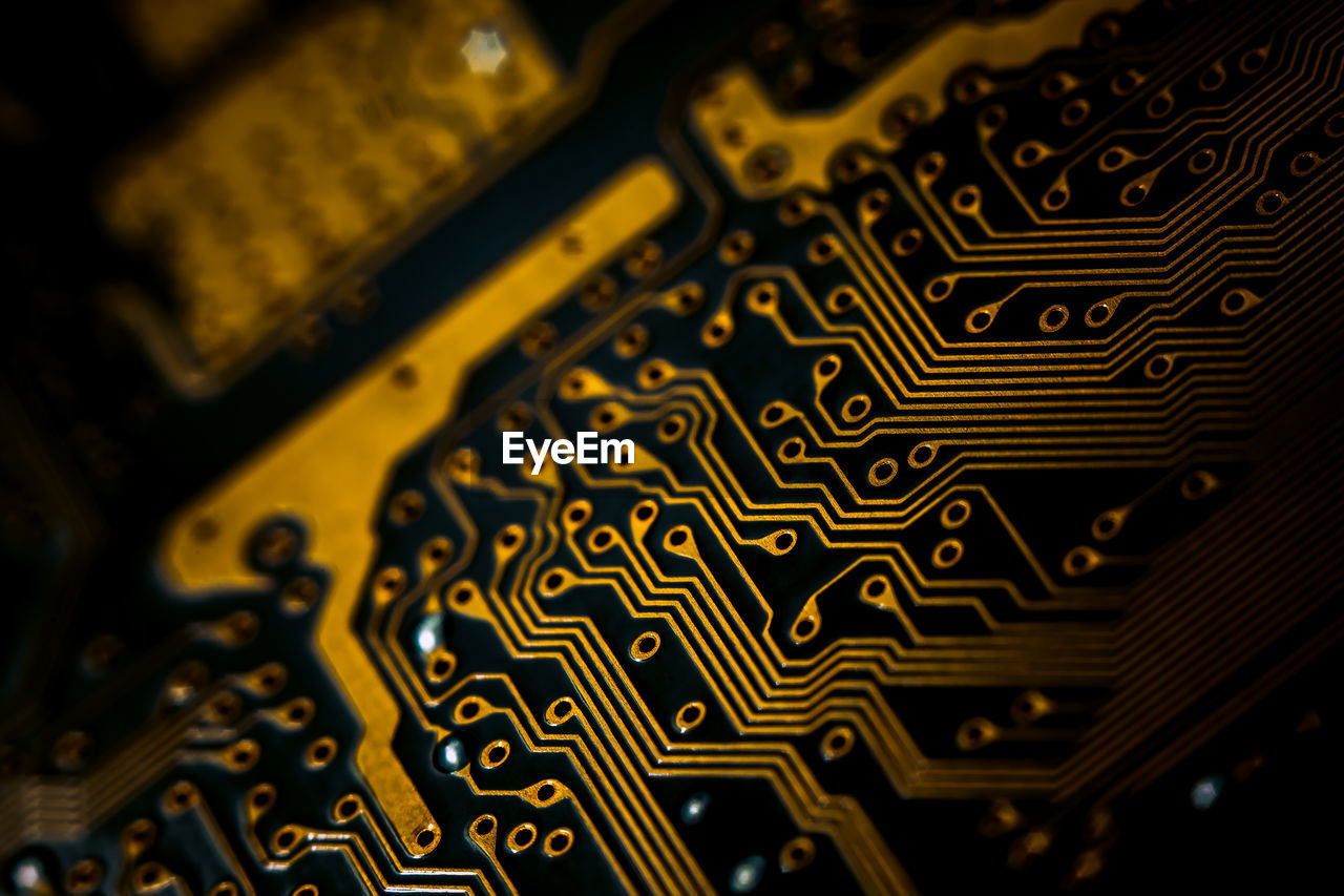 no people, close-up, circuit board, backgrounds, selective focus, computer chip, indoors, electronics industry, technology, connection, high angle view, pattern, metal, full frame, computer part, industry, mother board, yellow, still life, complexity, electrical equipment
