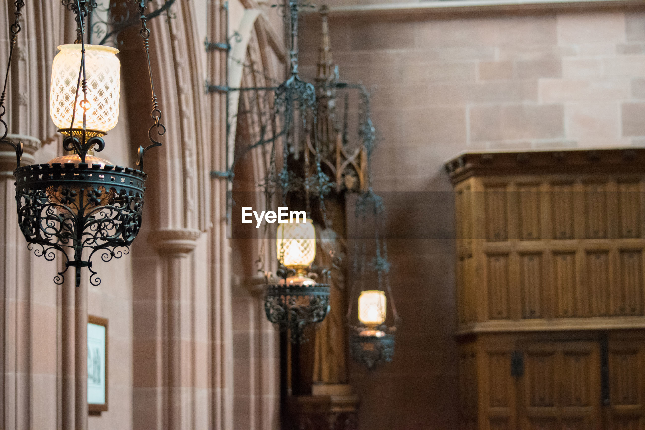 Lanterns hanging in historic building