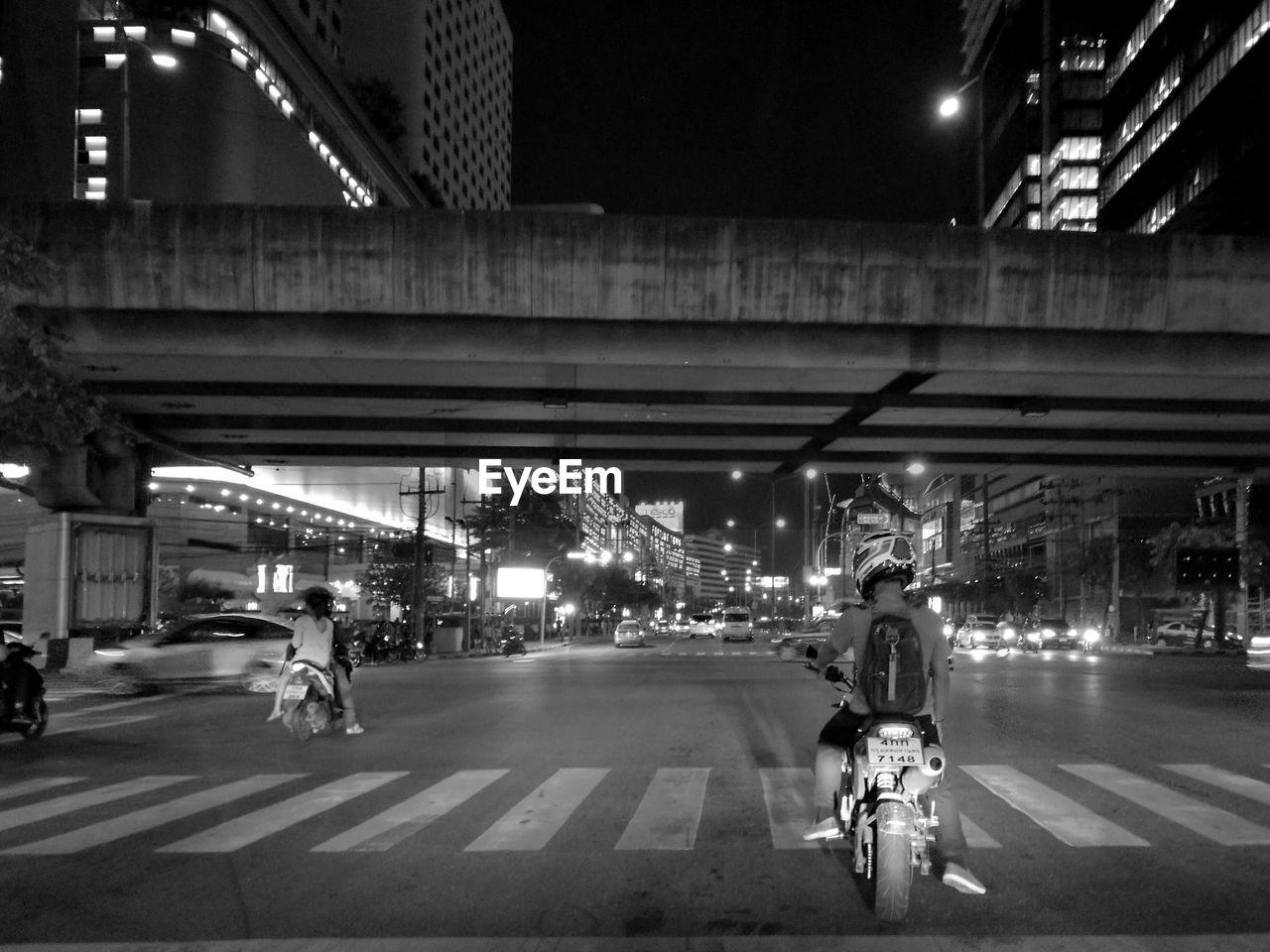 Man On Motorcycle On Street At Night