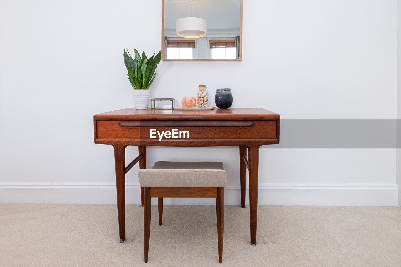 TABLE AND CHAIRS AT HOME AGAINST WALL
