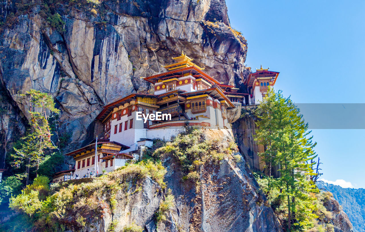 Buddhist Temples On Cliff Against Mountains