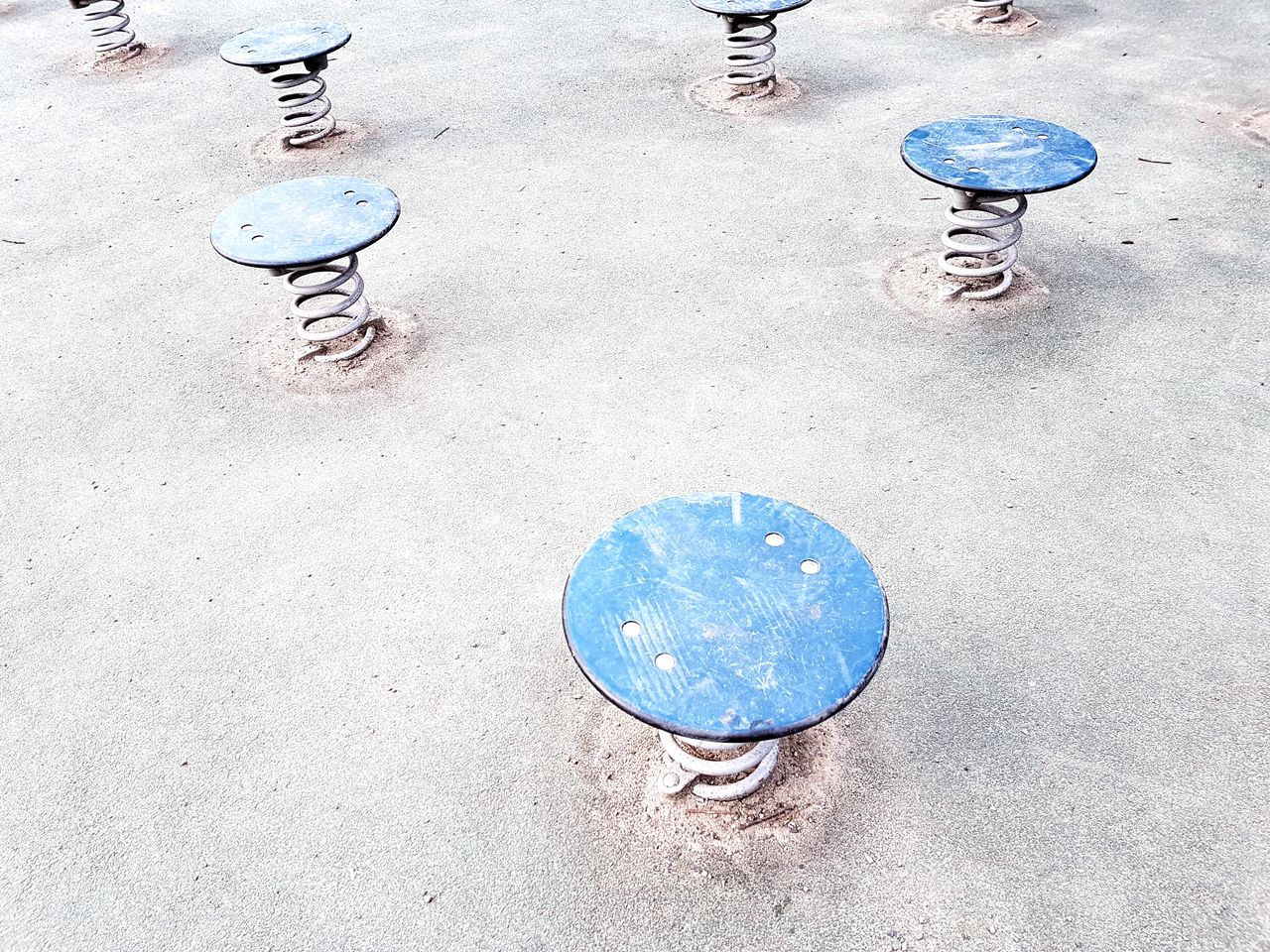 high angle view, circle, playground, low section, day, skateboard park, leisure games, outdoors, shoe, childhood, outdoor play equipment, sport, playing, one person, real people, men, hopscotch, people