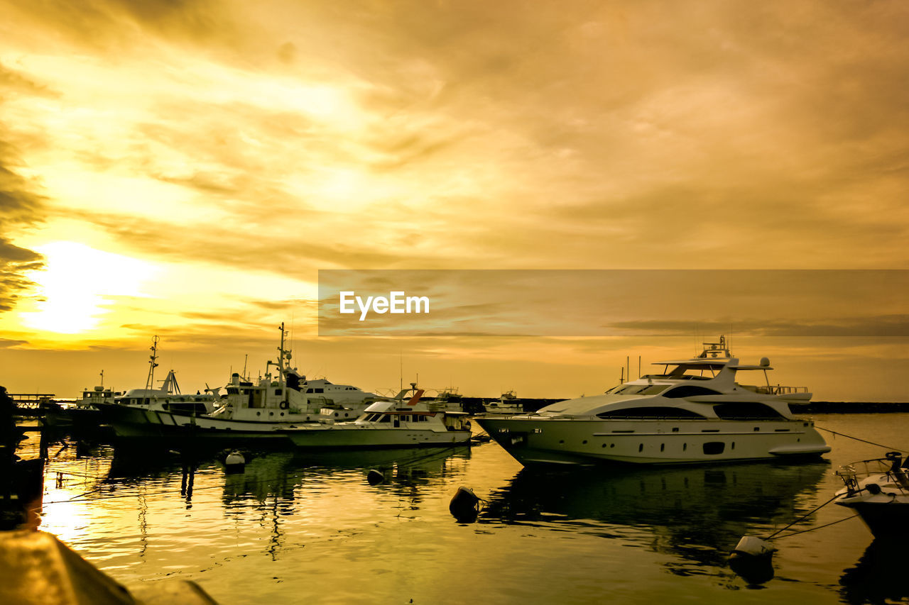 nautical vessel, transportation, sunset, water, mode of transport, moored, sky, reflection, harbor, cloud - sky, orange color, boat, sea, nature, yacht, outdoors, no people, beauty in nature, shipyard, day