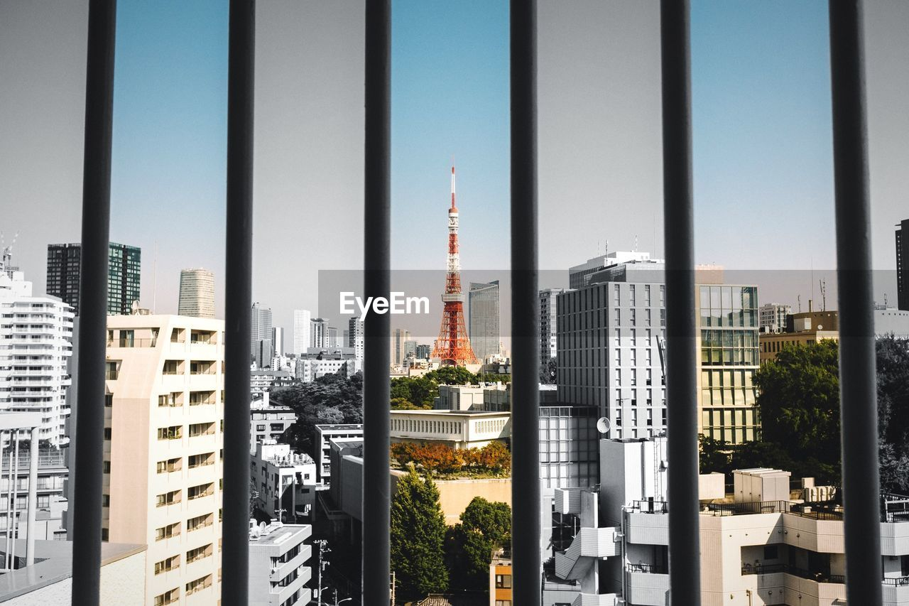 Tokyo tower and cityscape seen through window