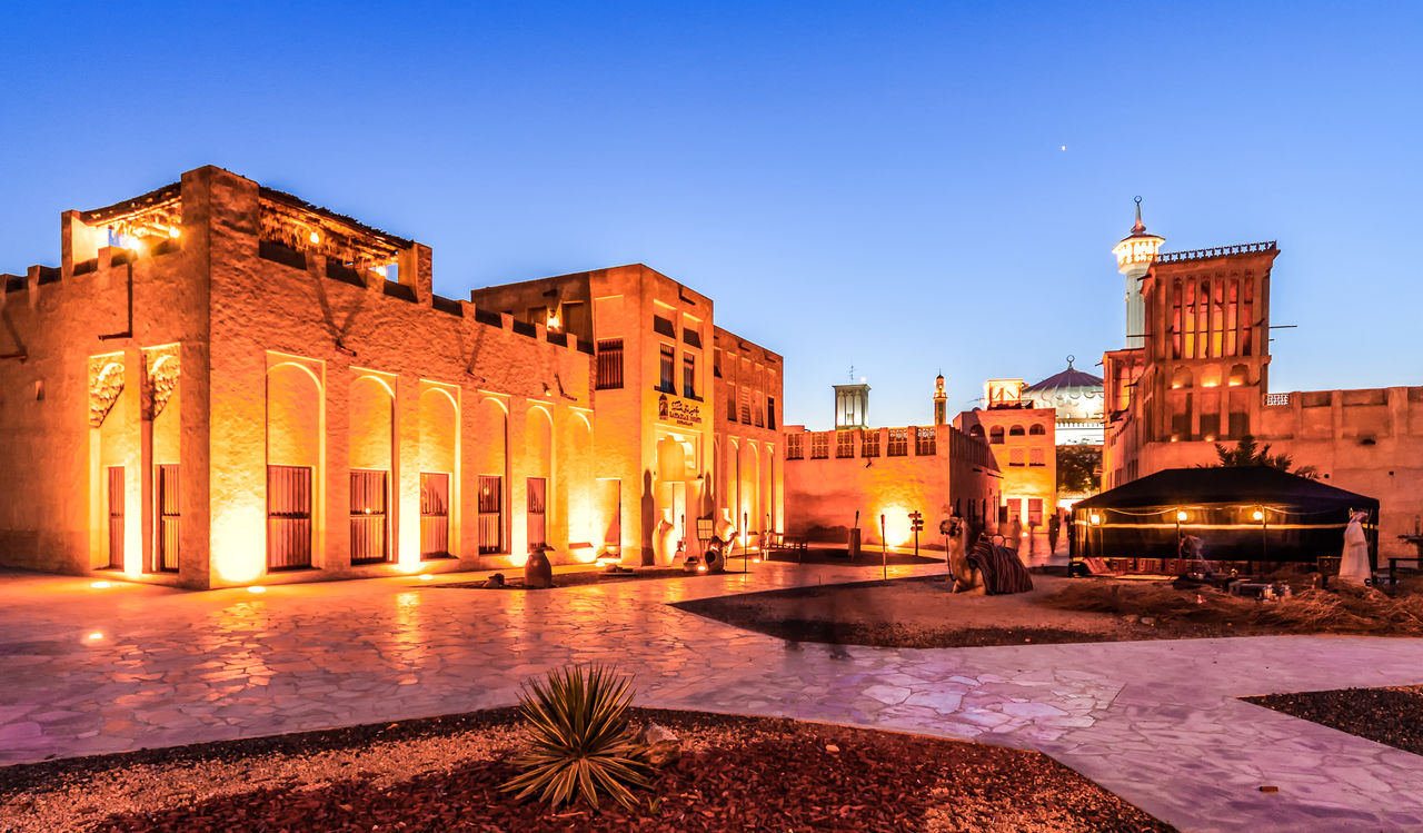 architecture, built structure, building exterior, illuminated, sky, building, city, nature, clear sky, blue, night, dusk, no people, history, the past, travel destinations, outdoors, copy space, street, lighting equipment