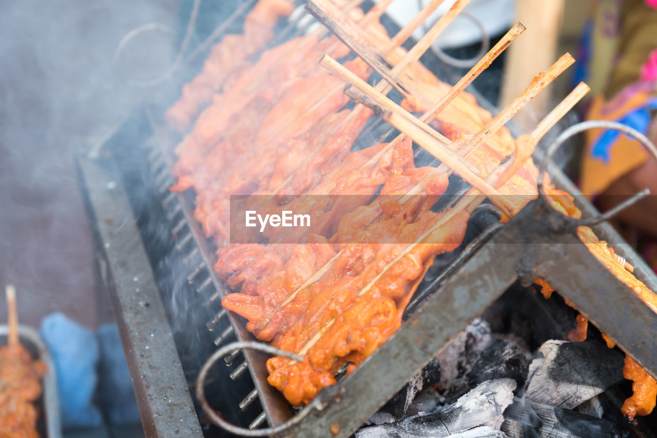 burning, barbecue grill, heat - temperature, barbecue, food and drink, coal, food, flame, outdoors, grilled, smoke - physical structure, high angle view, meat, day, freshness, ash, no people, close-up