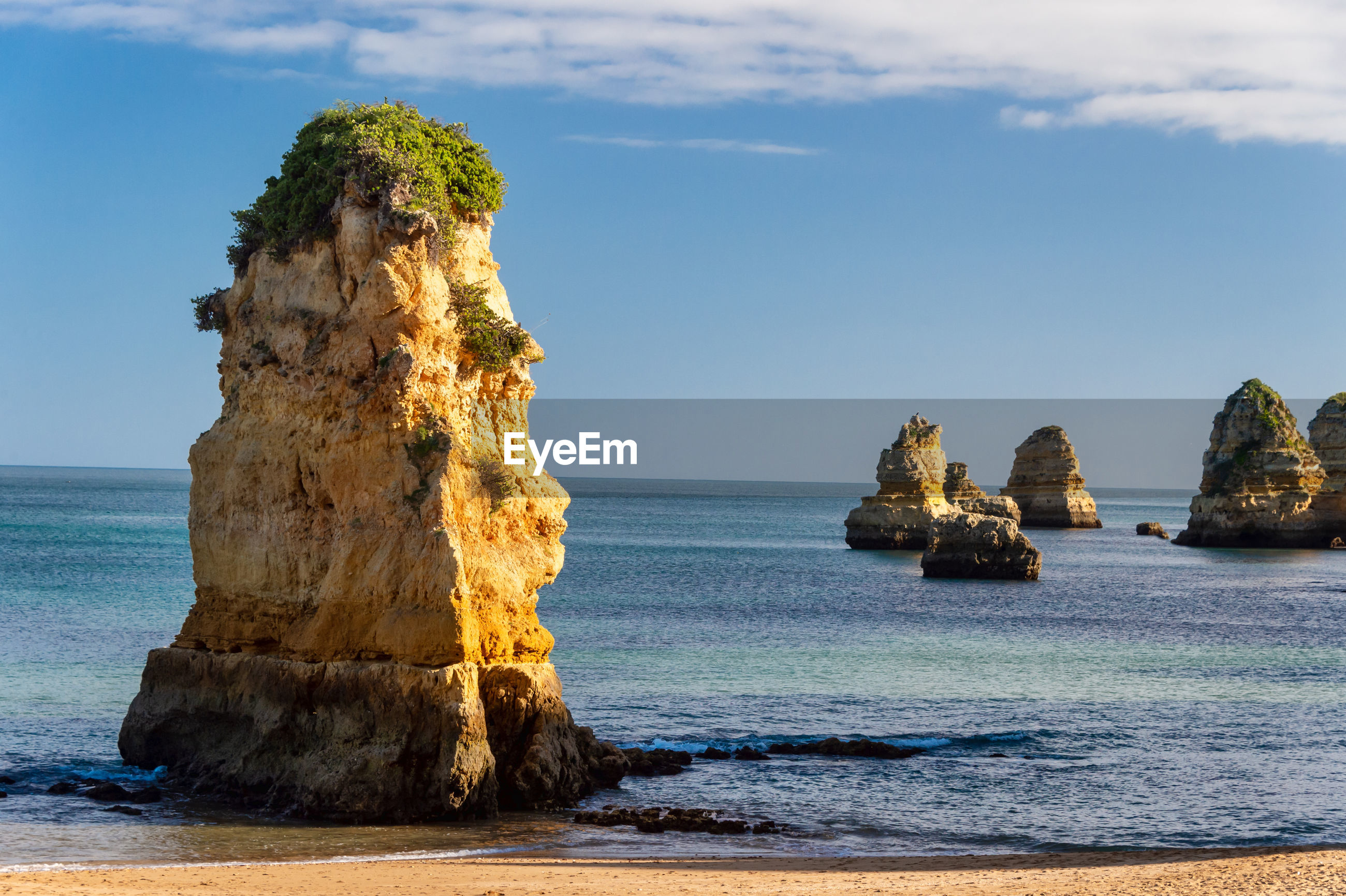 SCENIC VIEW OF ROCK FORMATION ON BEACH AGAINST SKY